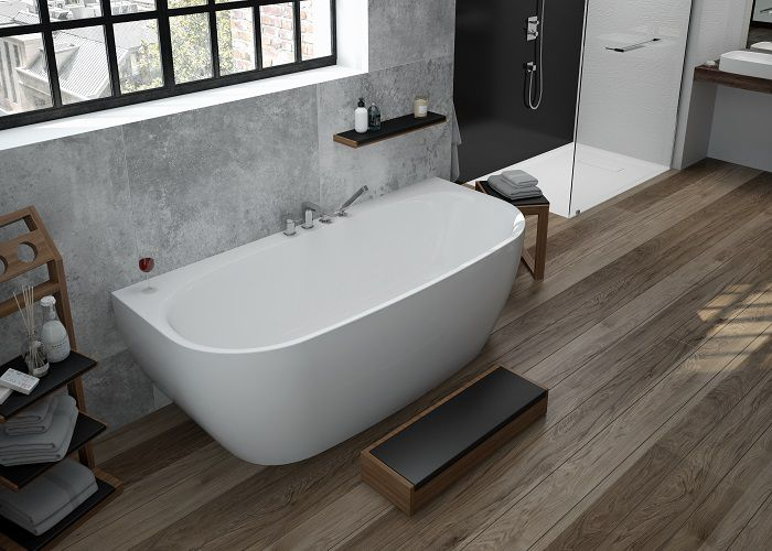 Image shows bathtub comprises drain/overflow fitting